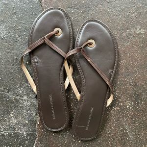 Brown, leather flip-flops.